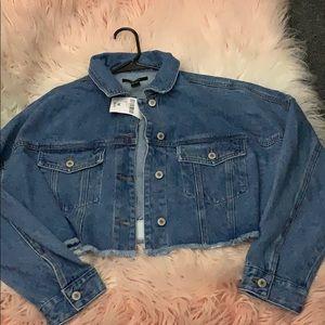 Cropped medium wash denim jacket